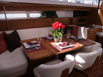 Modern yacht interior. Mahogany furniture and finish in the dining room Stock Images