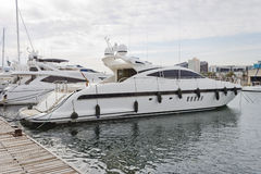 Modern yacht moored on the pier Royalty Free Stock Photo