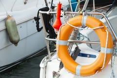 Modern yacht safety equipment, orange lifebuoy Stock Photos