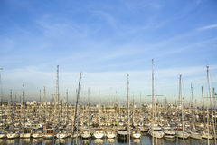 Modern yachts at sea port in Barcelona, Spain. Royalty Free Stock Photography