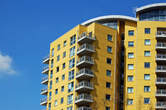 Modern yellow apartments Stock Images
