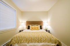 Modern yellow bedroom Stock Photos
