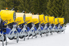 Modern yellow cannons at Bansko ski slope Bulgaria Stock Photos