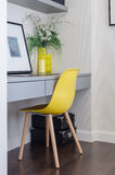 Modern yellow chair with grey table Stock Photography