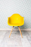 Modern yellow chair. In room Stock Image
