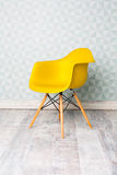 Modern yellow chair stock images
