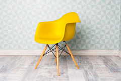 Modern yellow chair. In room Royalty Free Stock Photos