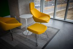 Modern yellow chairs Stock Images