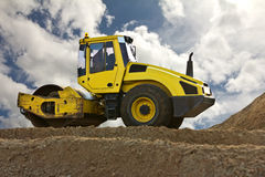 Modern yellow excavator machines Royalty Free Stock Photography