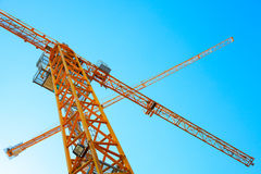 Modern yellow industrial cranes above blue sky Stock Photography