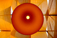 Modern yellow lamp. On a background of yellow cloth Stock Photo