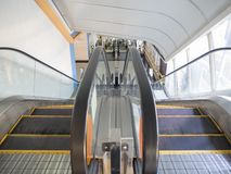 Modern yellow line escalator in shopping mall stock image