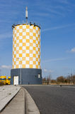 Modern yellow white chequered watertower Stock Image