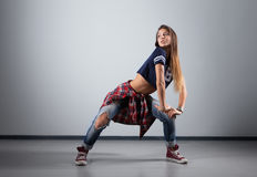 Modern young beautiful dancer posing on a studio background Stock Photography