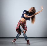 Modern young beautiful dancer posing on a studio background Royalty Free Stock Images