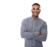 Modern young black man smiling with arms crossed Stock Images