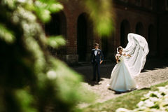 Modern young couple and the arches behind Stock Images