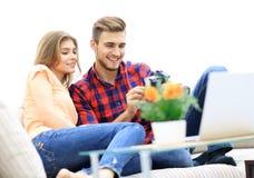 Modern young couple checks the photos on the camera stock photos