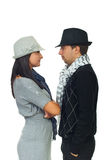Modern young couple in hats Royalty Free Stock Photos