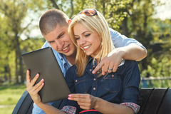 Modern young couple using a digital tablet Royalty Free Stock Photos