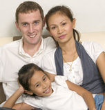 Modern young family with little girl Stock Image