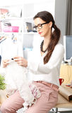 Modern young fashion designer working Stock Photos