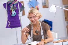 Modern young fashion designer working at studio. Royalty Free Stock Photography