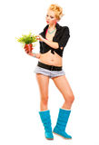 Modern young girl looking on flower in hand Royalty Free Stock Photo