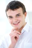 Modern young man. Business portrait of positivity young man in white Royalty Free Stock Images