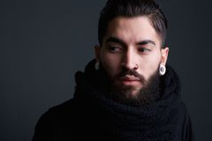 Modern young man with beard and piercings Stock Photo