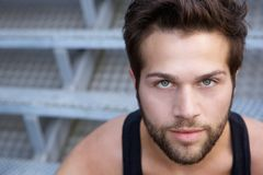 Modern young man with beard staring. Close up portrait of a modern young man with beard staring Royalty Free Stock Photos