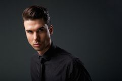 Modern young man with cool hairstyle Stock Photos