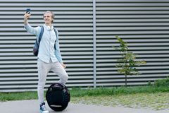 Business man male with electric transport doing selfie stock images