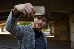 Modern young man smartphone taking selfie Royalty Free Stock Photos