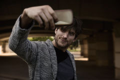 Modern young man smartphone taking selfie Royalty Free Stock Image