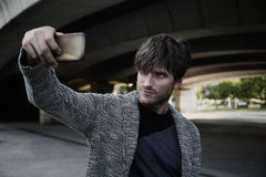Modern young man smartphone taking selfie Stock Images