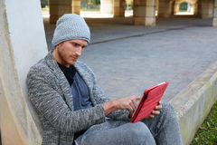 Modern young man with tablet pc under a bridge Royalty Free Stock Photos