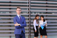 Modern young masculine guy businessman, student in foreground in. Handsome confident young male guy businessman, office worker, student posing in front for Royalty Free Stock Photos