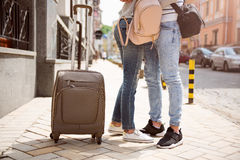 Modern young people in a big city. Togetherness. Cropped picture of two young people travelling together and arming each other being in a big city Royalty Free Stock Photo