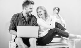 Modern young people leisure internet surfing. Surfing web together. Couple cheerful spend leisure with laptop surfing stock image