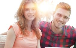 Modern young people using laptop at home. Smiling modern young people using laptop at home Royalty Free Stock Images