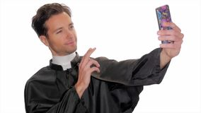 Modern young priest taking a selfie stock video