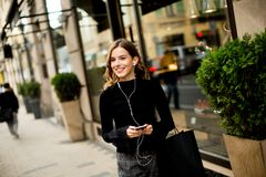 Modern young shopaholic woman on street Royalty Free Stock Images