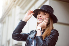 Modern young woman in a big city Stock Images