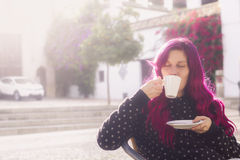 Modern young woman drinking coffee stock image