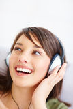 Modern young woman listening to music Royalty Free Stock Images