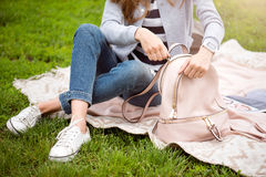 Modern young woman in a park Stock Photo
