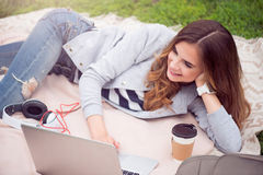 Modern young woman in a park Royalty Free Stock Photography