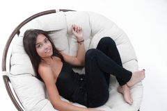 Young woman resting in big comfortable armchair Royalty Free Stock Image