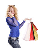 Modern young woman shopping and talking on cell Stock Photo